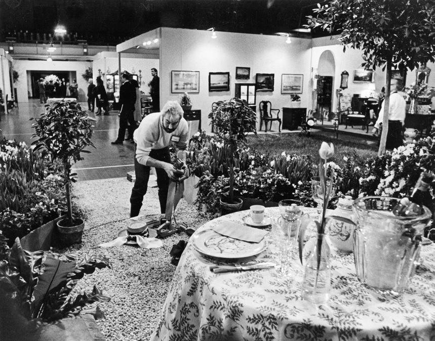 Winter Antiques Show, 1970. Finishing touches to the Conservatory Garden centrepiece.